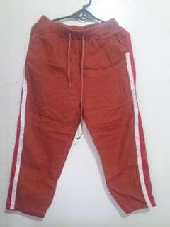 Orange pants w/ white & red lines