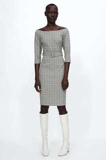 Low shoulder dress