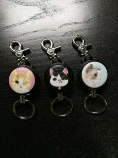 Macaron reels with retractable wire, keyring, back clip and carabiner (Cat Series)
