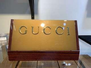 Gucci display plaque