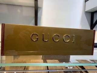 Gucci plaque display