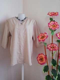 Light beige blouse
