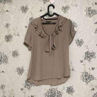 Beige top the executive