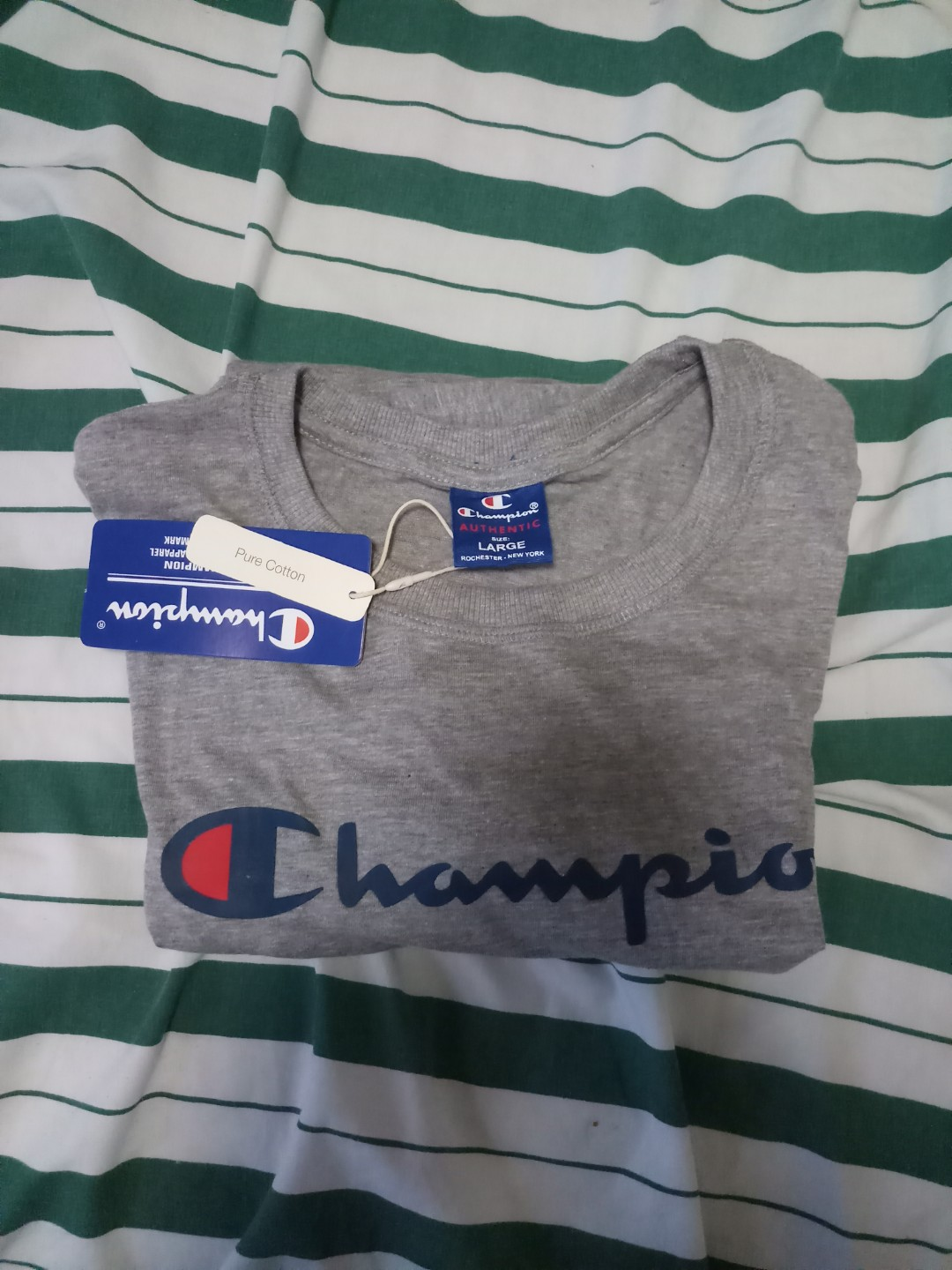 517f8cb0e Champion Tshirt, Men's Fashion, Clothes, Tops on Carousell