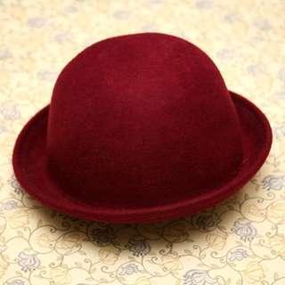 Round woollen bowler hat