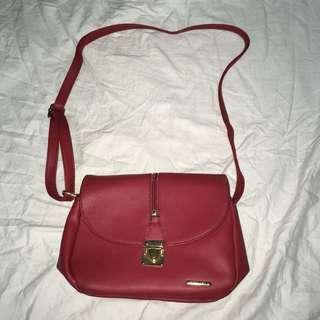 michaela red sling bag