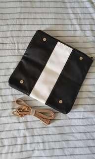 Monochrome sling clutch bag