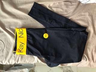 Nicky Kay orange band seamless leggings