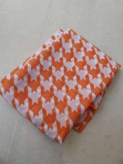Orange houndstooth shawl
