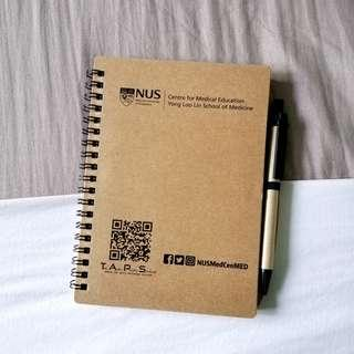 nus yll sch of med notebook and pen