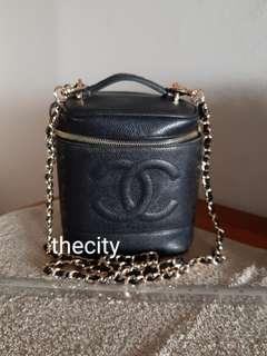 AUTHENTIC CHANEL TALL VANITY BAG - BLACK CAVIAR LEATHER - CLEAN INTERIOR- CAVIAR LEATHER IN VERY GOOD CONDITION - SOLID SHAPE STRUCTURE - REPLACEMENT CHARMS ZIP PULL - HOLOGRAM SERIAL STICKER IS INTACT - COMES WITH EXTRA LONG CHAIN STRAP