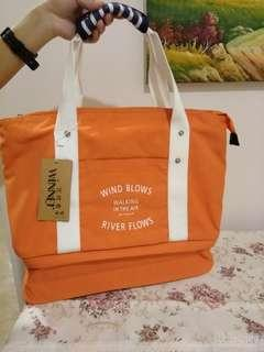 Bright orange hand carry bag