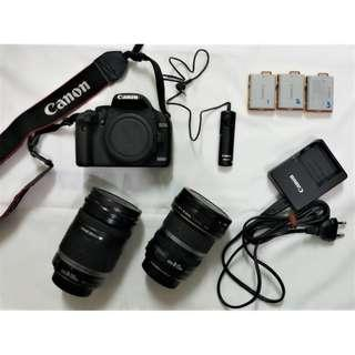 $1000 - Canon EOS 500D body + 2 lenses + shutter release remote + 3x Canon battery pack 1