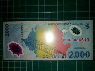 [Europe] Romania 2000 Lei Polymer Note (1999 Series)