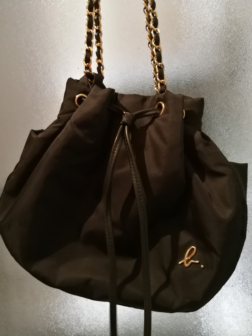 e76c345ae984 Authentic Agnes B sling bag with gold chain