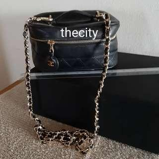 AUTHENTIC CHANEL FULL LAMBSKIN LEATHER VANITY BAG - BLACK COLOUR - CLEAN INTERIOR- LAMBSKIN LEATHER IN GOOD CONDITION - SOLID SHAPE STRUCTURE - HOLOGRAM SERIAL STICKER IS INTACT - COMES WITH EXTRA LONG CHAIN STRAP FOR SLING / CROSSBODY -