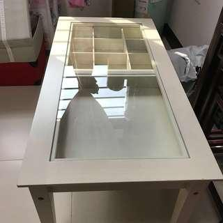 White coffee table with glass display top and drawer