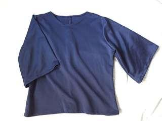 Blue bell-sleeved blouse