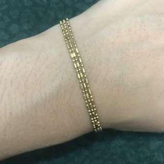 18 karat 3 layered bracelet approximately 3.9 grams. 8.46 inches long