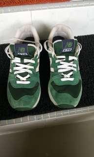 New Balance 574 running shoes.