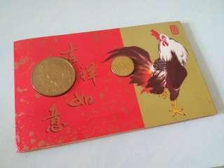 1993 Year of the Rooster $2 note, $1 coin and another gold coin. Issued by the singapore mint.