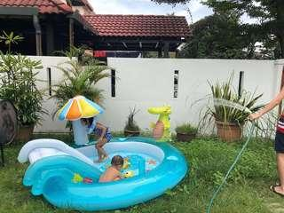 Swimming pool with slide