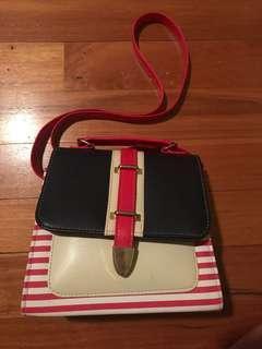 Navy blue and pink handbag