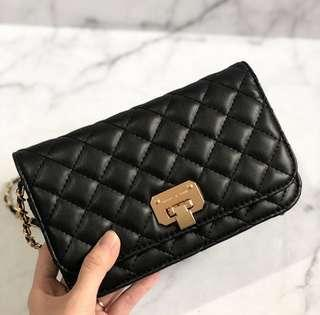 CK quilted clutch