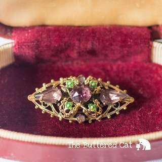 Vintage ornate brass brooch with purple paste stones