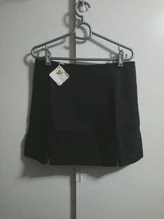 Black panel skirt with mini slit
