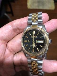 Ricoh half gold watch