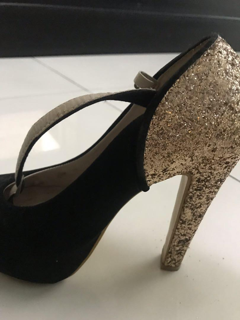 Black and glitter heels