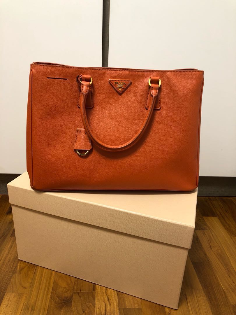 76d6221e42d1 Prada Saffiano Lux Tote BN1844 in Papaya, Luxury, Bags & Wallets ...