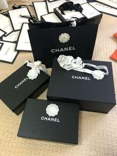 Hermes Gucci Chanel Balenciaga boxes and paper bags