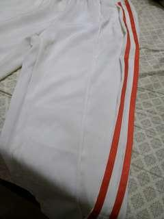 Track pants white with orange linings satin smooth fabric