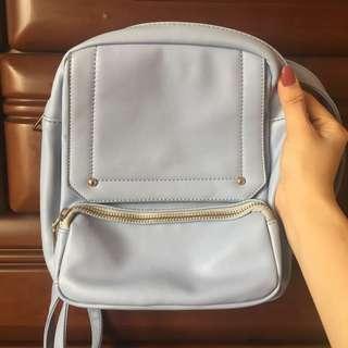 Powder blue sling/backpack bag