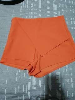 Asymmetrical orange layered shorts
