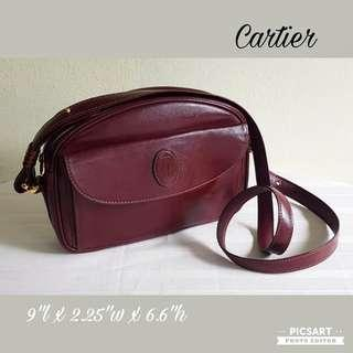 """Vintage Cartier Leather Burgundy tone. Still Good and Beautiful condition. 10"""" length x 2"""" width x 6.5"""" height.  $350, WhatsApp 96337309."""