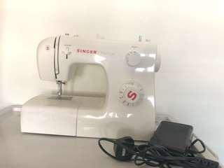 Singer sewing machine with accessories