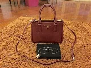 BNWOT AUTHENTIC GRADE PRADA MAROON SAFFIANO MINI 2-WAY SLING BAG WITH CARDS AND DUSTBAG