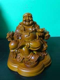 Wooden crave smiling Buddha