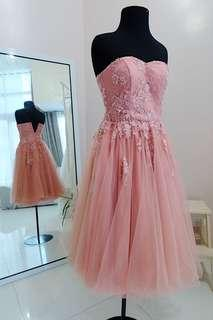 Peach beaded prom gown