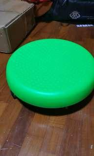 Low stool with reinforced wheels