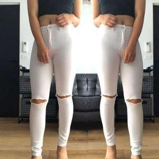 High waisted white jeans with rips