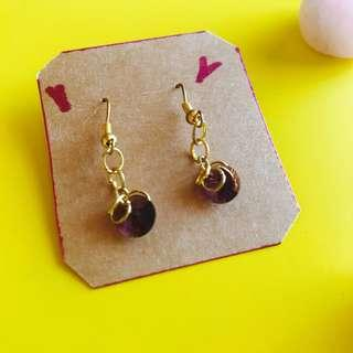 Earrings 'loopy' with purple crystals