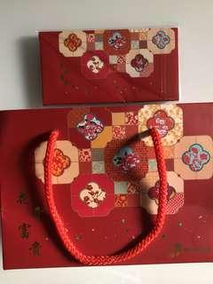 2019 set of Sembcorp Chinese New Year red packets and orange bag carrier for sale .
