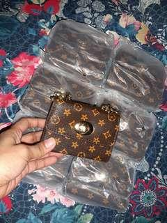 Lv mini sling bag for your little one.