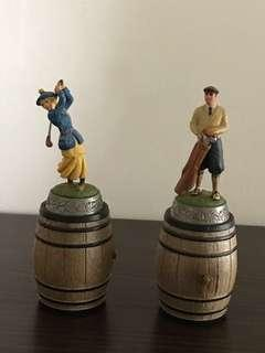 A pair of wine bottle stopper for golf enthusiasts