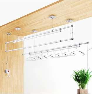 Elevating double pole clothes rack