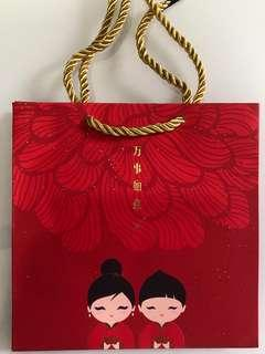 2019 DBS Treasures Chinese New Year red packets and orange Carrier bag for sale .